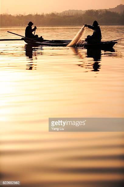 Fishermen Hauling in Nets