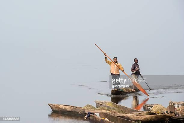 Fishermen in a pirogue on Congo River