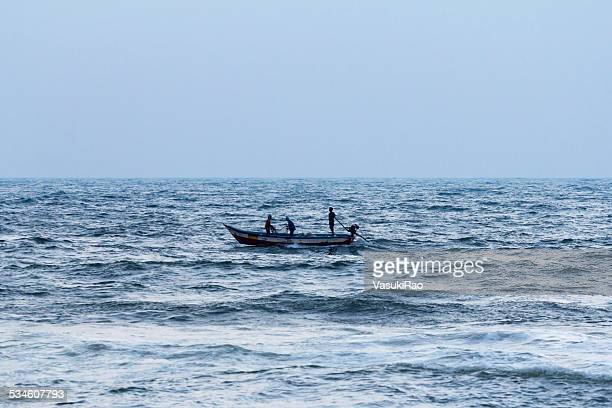 fishermen in boat, chennai, india - tamil nadu stock pictures, royalty-free photos & images