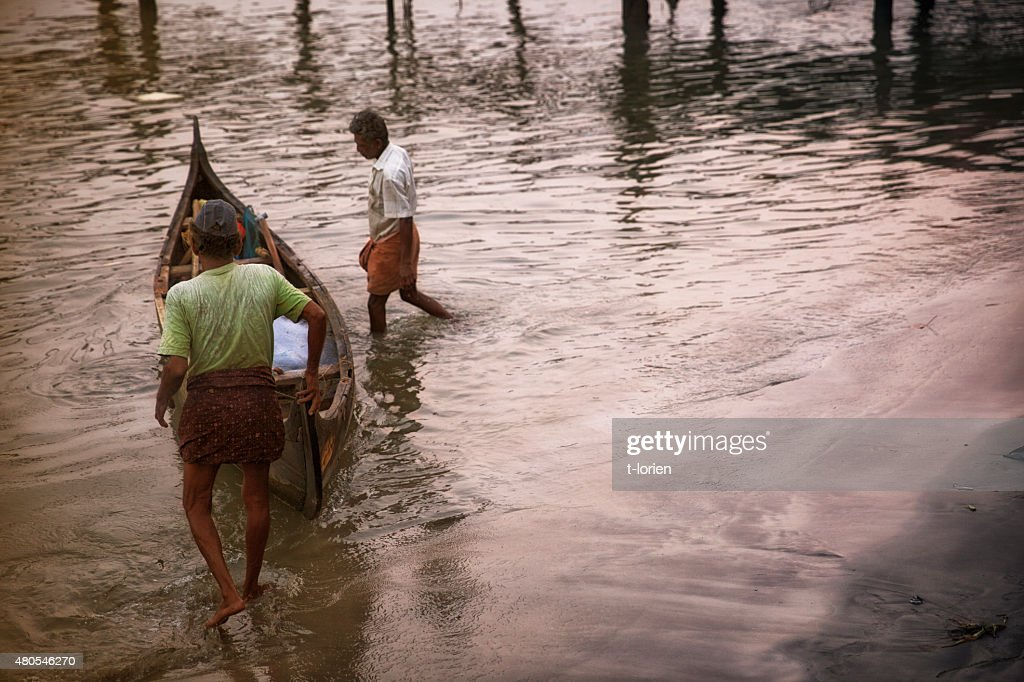 Fishermen in early morning. Cochin, India : Stock Photo
