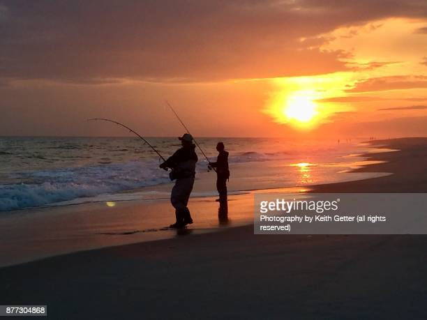 fishermen in reverie with nature  at the ocean's edge - jones beach stock pictures, royalty-free photos & images