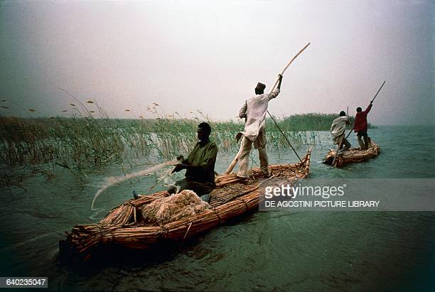 Fishermen in two canoes on the waters of Lake Chad Chad