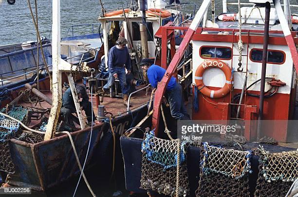 fishermen in wales - solo adulti foto e immagini stock