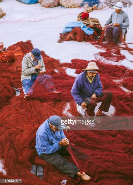 fishermen knitting - north africa stock pictures, royalty-free photos & images
