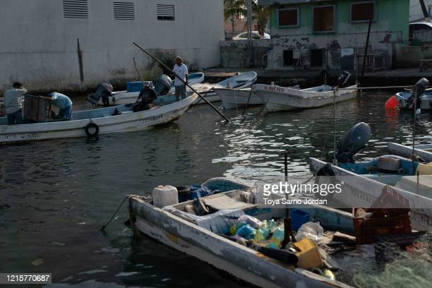 Fishermen leave a dock on May 25 2020 in Veracruz Mexico Fishermen claim a decrease on sales around 50% due to the COVID19 pandemic making it even...