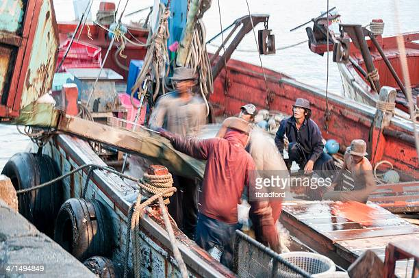 fishermen load ice onto their boat - hua hin thailand stock pictures, royalty-free photos & images