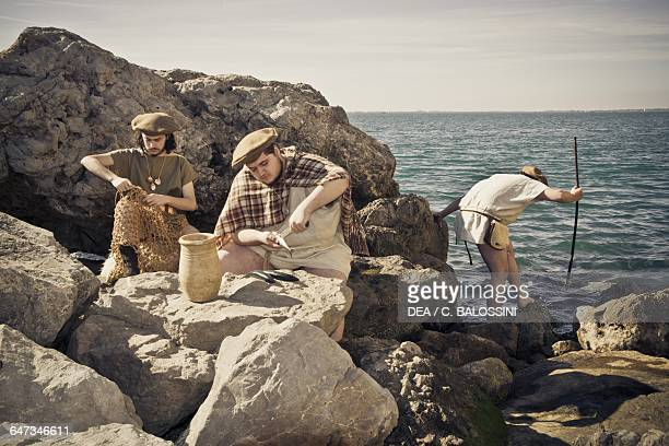 Fishermen mending nets cleaning fish and fishing Illyrian civilisation mid3rd century BC Historical reenactment