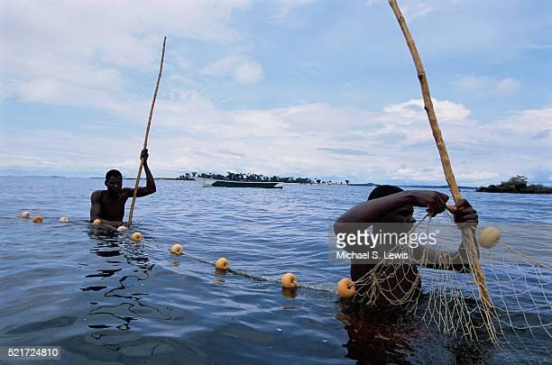 Fishermen Moving Nets