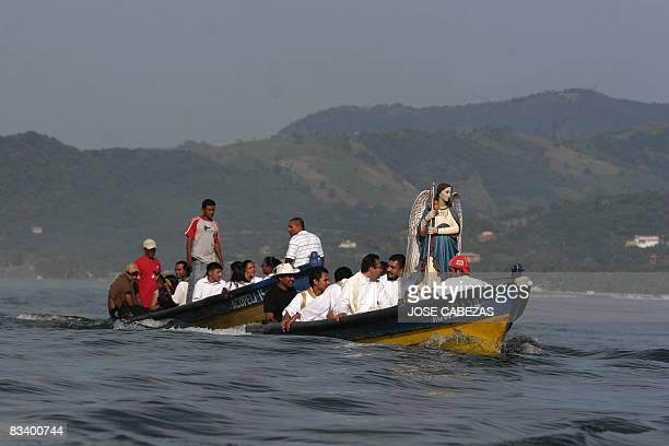Fishermen navigate in procession in homage to Saint Raphael Archangel at the port of La Libertad 35 km south of San Salvador on October 23 2008 Saint...