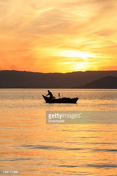 Fishermen on boat at sunset, Florianopolis