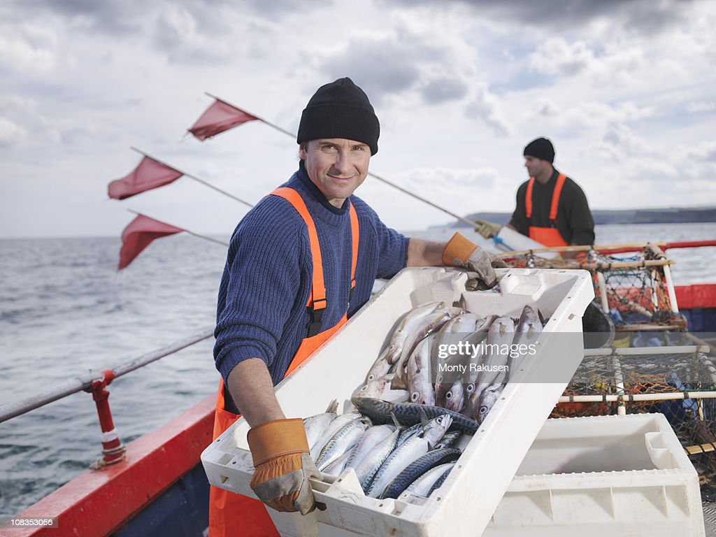 Fishermen on boat with catch of fish : Stock Photo