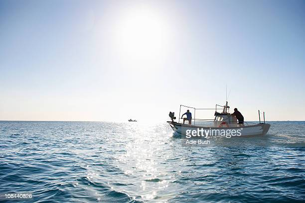 Fishermen on fishing boat at sea