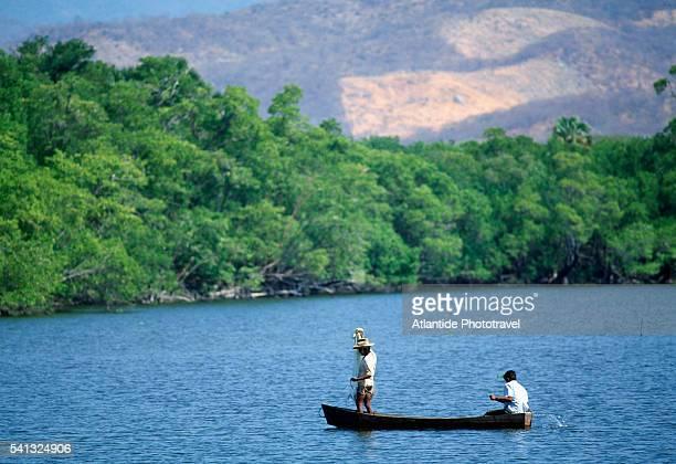 fishermen on laguna manialtepec - lagoon stock pictures, royalty-free photos & images