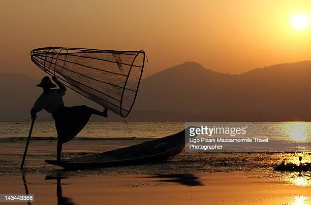 Fishermen on lake in Myanmar