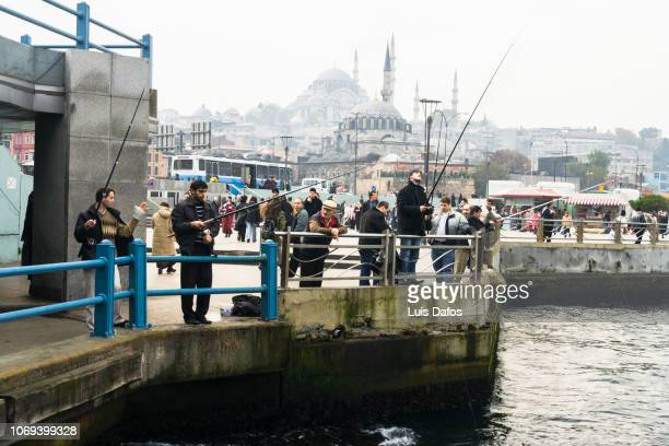 fishermen on the golden horn - dafos stock photos and pictures