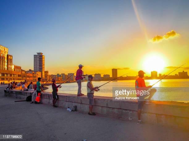 Fishermen on the Malecon in Havana, cuba