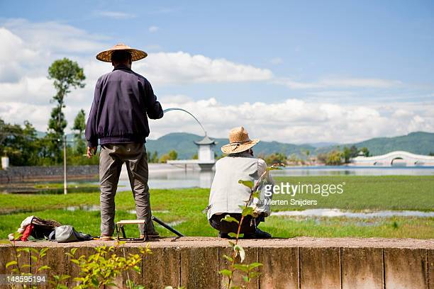 fishermen on wall. - merten snijders stock pictures, royalty-free photos & images