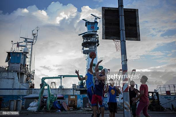 Fishermen play basketball in front of a fishing boat on July 13 2016 in Kaohsiung Taiwan Taiwan often an overlooked player in the control over the...