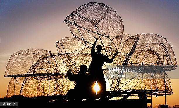 Fishermen prepare their boat with traps in the Dhow Harbour April 27 2003 in Doha Qatar The fishermen will spend up to 4 days in the Gulf fishing for...