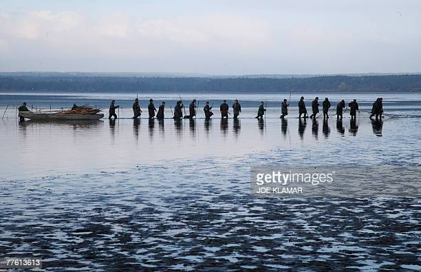 Fishermen prepare their nets early morning for the traditional Carp haul in the lake of Dvoriste near the south Bohemian town of Trebonon 31 October...