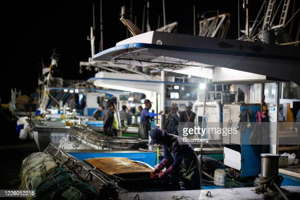 Fishermen prepare to depart a port at dawn on Yeonpyeong Island South Korea on Friday June 26 2020 On the sleepy island of Yeonpyeong the threat of...