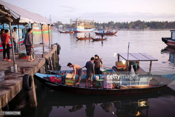 Fishermen prepare to offload fish from a boat at Tan Quang harbor in Quang Nam province Vietnam on Wednesday June 26 2019 Fishermen are on the front...