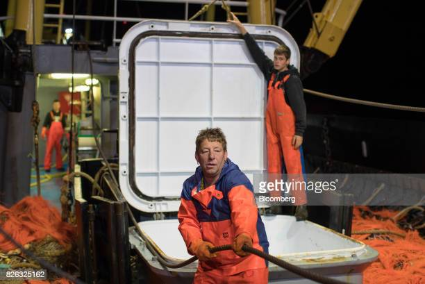 Fishermen prepare to unload their catch before sunrise at the port of Den Helder Netherlands on Friday Aug 4 2017 Prime Minister Theresa May will...