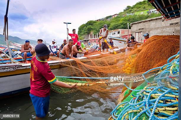 Fishermen preparing nets and boats for artisan fishing