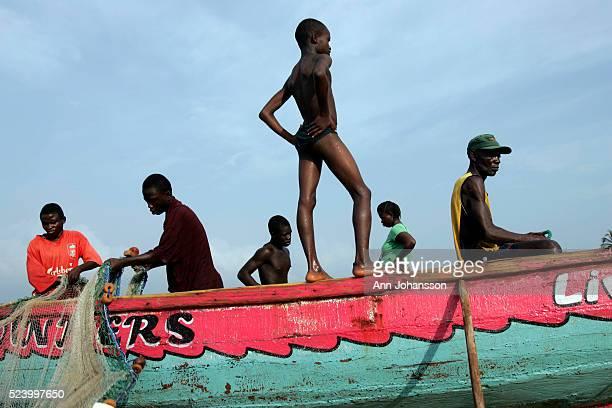 Fishermen pull in a net in Aberdeen near Freetown Sierra Leone November 15 2008 | Location Aberdeen Sierra Leone