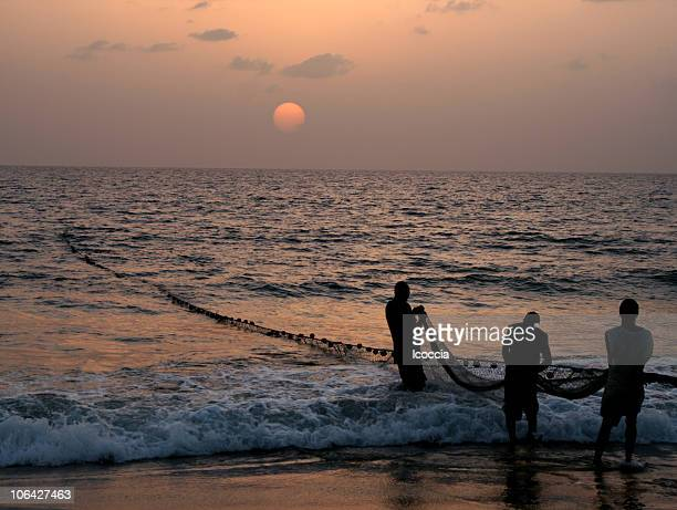 fishermen pulling net - sierra leone stock pictures, royalty-free photos & images