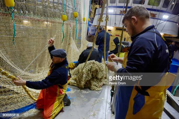 Fishermen repair pulse fishing nets in the port of Scheveningen on January 19 2018 in The Hague Netherlands A large majority of members of the...