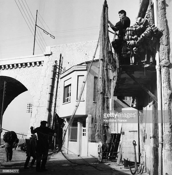 Fishermen Repairing Their Nets in Marseille France in 1956