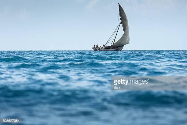 Fishermen returning from work at midday on Zanzibar Island off the coast of Tanzania, Africa