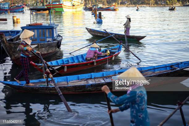Fishermen row boats near Tan Quang market in Quang Nam province Vietnam on Wednesday June 26 2019 Fishermen are on the front lines of Asias most...