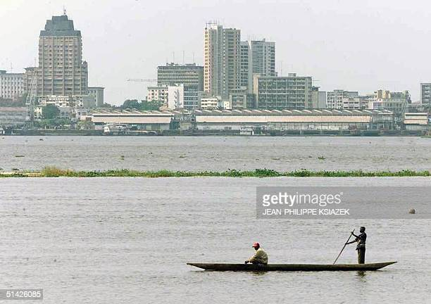 Fishermen sail 24 August on the river Congo that separates Brazzaville, Congo, from Kinshasa, Democratic Republic of Congo . Congolese authorities...