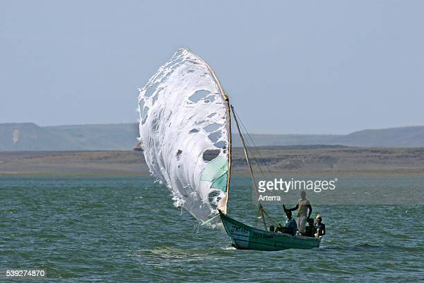 Fishermen sailing in wooden fishing boat on Lake Turkana, Kenya, East Africa.