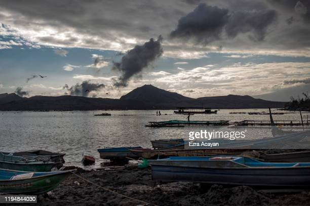 Fishermen set out to fish in Taal Lake near the erupting Taal Volcano on January 20 2020 in the village of Buso Buso Laurel Batangas province...