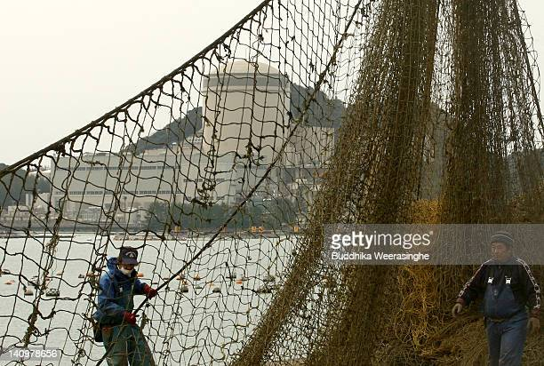 Fishermen set up fishing nets beside Mihama No 3 reactor at the The Mihama Nuclear Power Plant which is run by Kansai Electric Power Co on March 8...