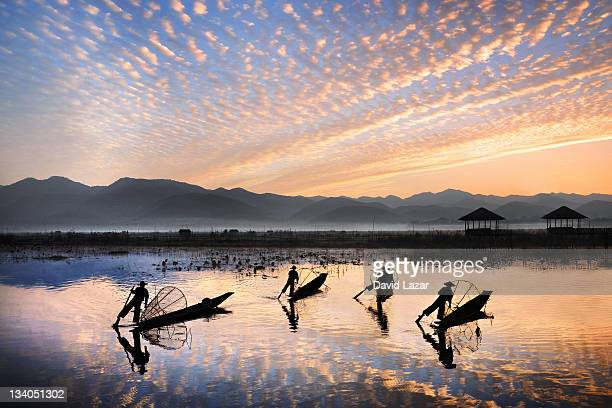 fishermen silhouettes - inle lake stock pictures, royalty-free photos & images