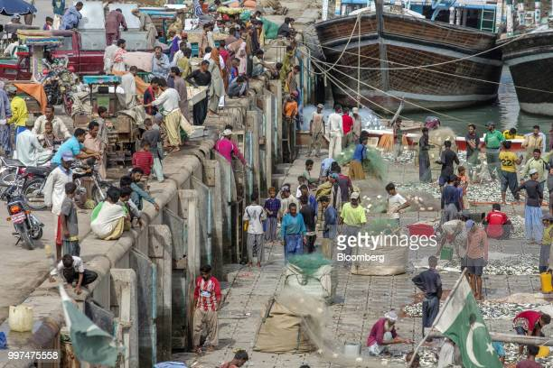 Fishermen sort their catches at the harbor in Gwadar Balochistan Pakistan on Tuesday July 4 2018 What used to be a small fishing town on the...