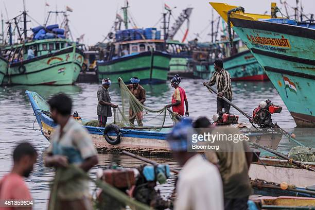 Fishermen tend to their nets near the Kasimedu fish market at the Royapurum fishing harbour in Chennai India on Wednesday July 15 2015 A banking...