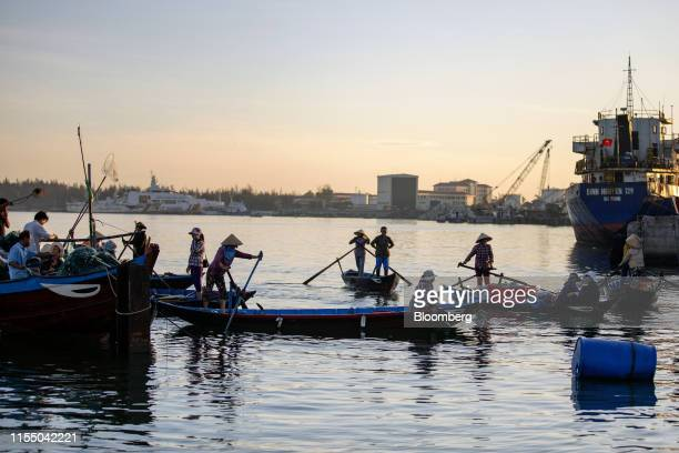 Fishermen transport fish on boats in Tan Quang harbor in Quang Nam province Vietnam on Wednesday June 26 2019 Fishermen are on the front lines of...