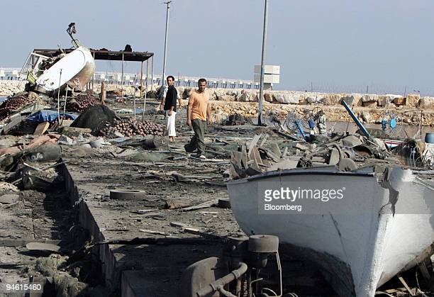 Fishermen try to salvage items from their boats in port of Ouzai near Beirut, Lebanon on Friday, August 4, 2006. Israeli warplanes bombed Christian...
