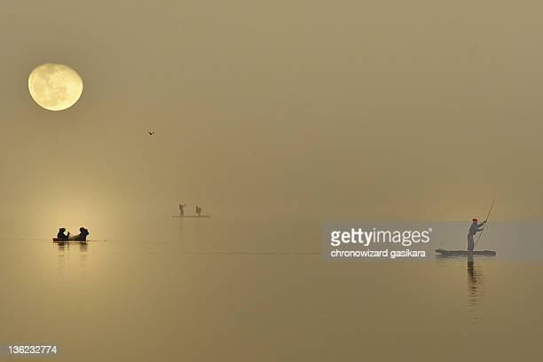 fishermen under moonlight - antananarivo stock photos and pictures