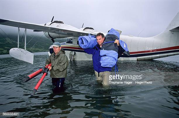 Fishermen unloading float plane