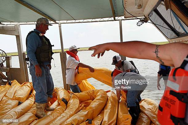 Fishermen use their shrimp boat to place oil booms into the water in an effort to protect the coast line from the massive oil spill on May 8 2010...