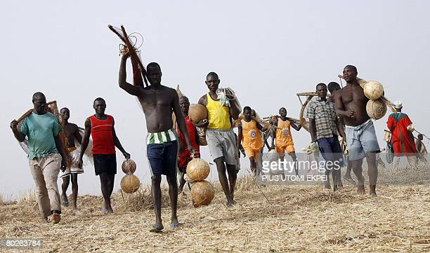 Fishermen walk to Argungu River to catch fish during the grand finale of Argungu fishing festival on March 15 2008Over 30 thousand fishermen from...