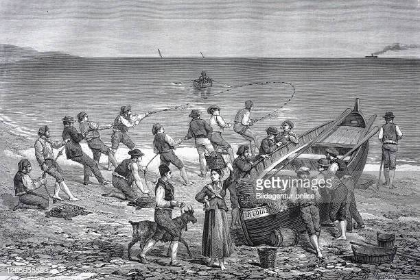 Fishermen with ab boat on the beach at Menton, commune in the Alpes-Maritimes department in the Provence-Alpes-Côte d'Azur region on the French...