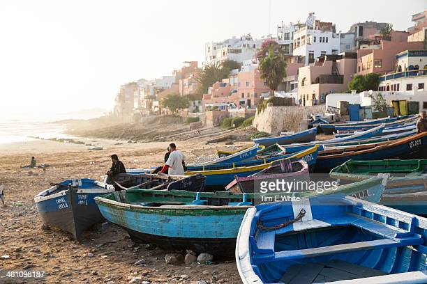 fishermen with boats on the beach at taghazout, mo - agadir stock pictures, royalty-free photos & images