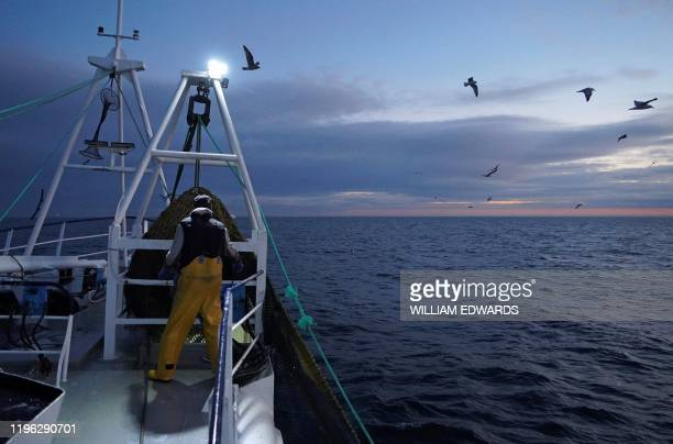 Fishermen work aboard the Good Fellowship fishing trawler while its nets trawl the sea bed for prawns and other crustaceans in the North Sea off the...